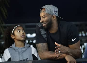 Former Los Angeles Laker Kobe Bryant and his daughter Gianna, both killed in a helicopter crash Jan. 26, 2019, are pictured watching the U.S. national championships swimming meet July 26, 2018, in Irvine, Calif. (AP Photo/Chris Carlson) (Chris Carlson/)
