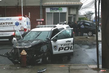 A SUV went into a building following a crash with a Trenton police car Saturday afternoon. (Photo courtesy of Brian McCarthy) (Brian McCarthy/)