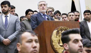 Afghanistan's Chief Executive Dr. Abdullah Abdullah, center, addresses the media following a conference with his party members in Kabul on Sunday.