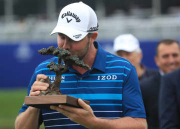 Marc Leishman of Australia poses with the Torrey Pines trophy after winning the final round of the Farmers Insurance Open at Torrey Pines South on January 26, 2020 in San Diego, CA. - Sean M. Haffey/Getty Images North America/TNS