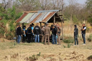 Police examine the shelter in a rice field Khon Kaen's Muang district where a monk was found dead on Monday. (Photo by Chakkrapan Natanri)