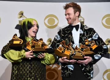 LOS ANGELES, CALIFORNIA - JANUARY 26: (L-R) Billie Eilish, winner of Record of the Year for