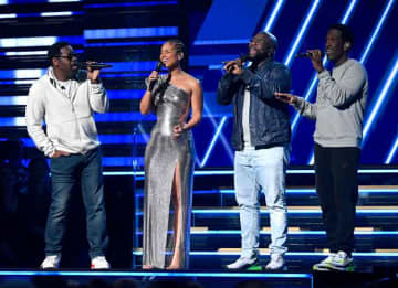 LOS ANGELES, CALIFORNIA - JANUARY 26: Alicia Keys (2nd from L) and Nathan Morris, Wanya Morris, and Shawn Stockman of Boyz II Men perform onstage during the 62nd Annual GRAMMY Awards at Staples Center on January 26, 2020 in Los Angeles, California.