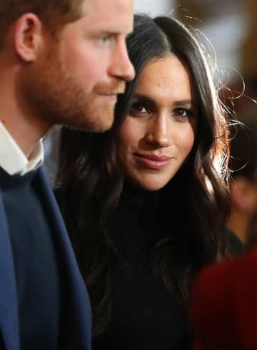 Prince Harry and Meghan Markle during a reception at the Palace of Holyroodhouse, in Edinburgh, during their visit to Scotland on January 23, 2018. - Andrew Milligan/PA Wire/Abaca Press/TNS