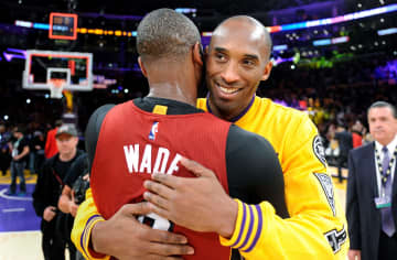The Los Angeles Lakers' Kobe Bryant hugs the Miami Heat's Dwayne Wade, left, after the Lakers' 102-100 overtime victory at Staples Center in Los Angeles on Wednesday, March 30, 2016. - Wally Skalij/Los Angeles Times/TNS