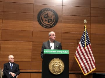 Wearing an appropriately green pocket square, Gov. Phil Murphy unveils the state's new energy master plan Monday at Stockton University in Galloway. (Brent Johnson/)