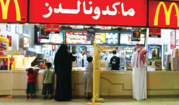 Segregation boards, such as this one pictured in a McDonald's restaurant in Riyadh in 2004, are no longer required under Saudi law.