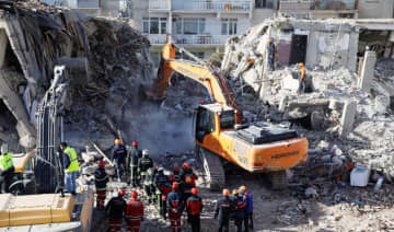 Search and rescue personnel work at the site of a collapsed building, after an earthquake with a magnitude of 6.8 in Elazig, Turkey, on Monday.