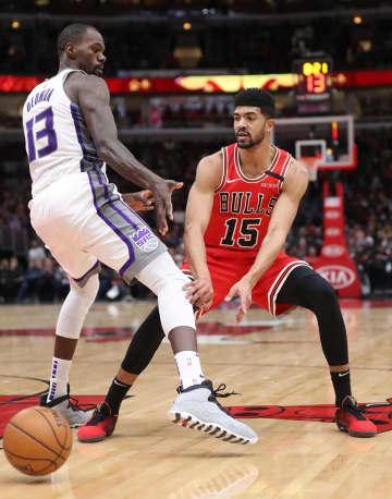 Chicago Bulls forward Chandler Hutchison (15) passes the ball as Sacramento Kings center Dewayne Dedmon (13) defends in the second quarter at the United Center Friday, Jan. 24, 2020, in Chicago. - John J. Kim/Chicago Tribune/TNS