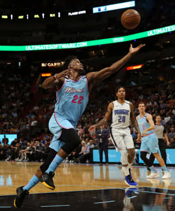 Miami Heat forward Jimmy Butler (22) goes for a loose ball in the first quarter of an NBA basketball regular season game against the Orlando Magic at the AmericanAirlines Arena on Monday, Jan. 27, 2020 in Miami. - DAVID SANTIAGO/Miami Herald/TNS
