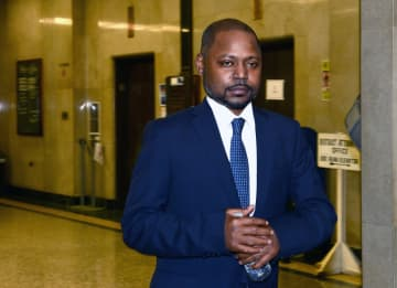 Nicki Minaj's brother Jelani Maraj exits the courtroom at Nassau County Court on Tuesday, Oct. 24, 2017 in Mineola, N.Y. Maraj was sentenced Monday to 25 years to life for raping his stepdaughter. - Debbie Egan-Chin/New York Daily News/TNS