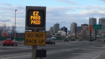 An E-Zpass sign tells drivers on the New Jersey Turnpike the electronic toll system has collected their toll. Drivers, who have a toll dispute in New York, can turn to a newly created advocate to help when there is a violation. (Larry Higgs/)