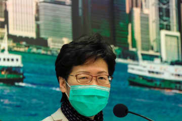 Hong Kong chief executive Carrie Lam wears a mask following the outbreak of a new coronavirus during a news conference, in Hong Kong on Tuesday. (Reuters photo)