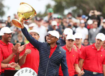 MELBOURNE, AUSTRALIA - DECEMBER 15: Playing Captain Tiger Woods and the United States team celebrate with the cup after they defeated the International team 16-14 during Sunday Singles matches on day four of the 2019 Presidents Cup at Royal...