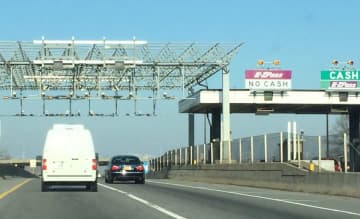 Vehicles pass under express E-ZPass gantries on the New Jersey Turnpike western spur. Two other busy turnpike exits will get similar express toll lanes. (Larry Higgs/)