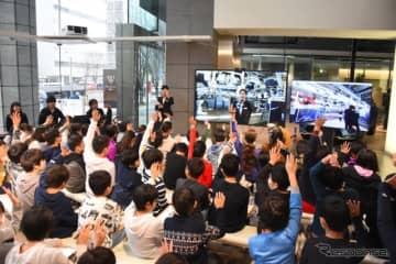 小学生を招いて「レクサス青山で九州の工場見学」が実施された。