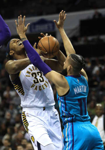 Cody Martin (11) of the Charlotte Hornets tries to stop Myles Turner (33) of the Indiana Pacers during their game at Spectrum Center on Jan. 6, 2020 in Charlotte, N.C. - Streeter Lecka/Getty Images North America/TNS