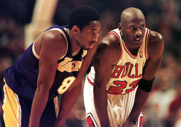 Los Angeles Lakers guard Kobe Bryant, left, and Chicago Bulls guard Michael Jordan talk during a free-throw attempt during the fourth quarter Dec. 17, 1997 at the United Center in Chicago. - VINCENT LAFORET/AFP/Getty Images North America/TNS