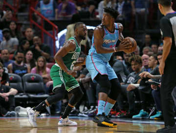 Miami Heat forward Jimmy Butler (22) drives against Boston Celtics guard Tremont Waters (51) in the second quarter on Tuesday, Jan. 28, 2020 at the AmericanAirlines Arena in Miami, Fla. - DAVID SANTIAGO/Miami Herald/TNS