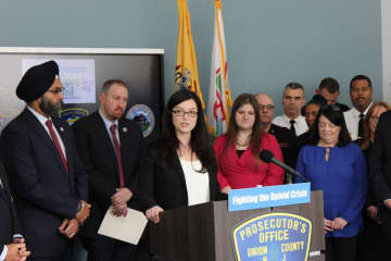 Acting Union County Prosecutor Lyndsay Ruotolo, at the podium, announces an expansion to Operation Helping Hand during a press conference with New Jersey Attorney General Gurbir Grewal (far left.) (Union County Prosecutor's Office/)