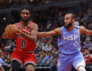 The Minnesota Timberwolves' Jordan McLaughlin (6) tries to knock the ball away from the Chicago Bulls' Coby White (0) at the United Center in Chicago on Wednesday, Jan. 22, 2020. - Jonathan Daniel/Getty Images North America/TNS