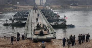 A US-South Korea joint river crossing exercise in the border county of Yeoncheon. The US and South Korea remain at an impasse over how they share the cost of funding US troops there.