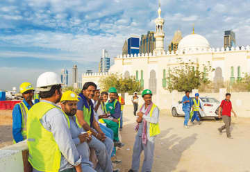 Construction workers in Dubai. The Gulf has become a labor migration hub in the region. (Shutterstock)