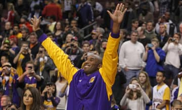Lakers' Kobe Bryant acknowledges someone in the crowd prior to Los Angeles' game against the Philadelphia 76ers at the Wells Fargo Center on Sunday, Dec. 16, 2012, in Philadelphia, Pa. - RON CORTES/The Philadelphia Inquirer/TNS