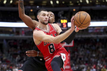 Zach LaVine makes a move around the Raptors' Norman Powell on Monday, Dec. 9, 2019 at the United Center. - Armando L. Sanchez/Chicago Tribune/TNS