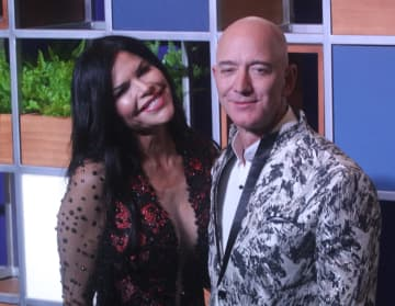 Amazon CEO Jeff Bezos, right along with American news anchor Lauren Sanchez poses for photographs during a blue carpet event organized by Amazon Prime Video in Mumbai, India on January 16, 2020. - Anadolu Agency/Getty Images North America/TNS