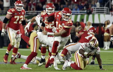 Kansas City Chiefs quarterback Patrick Mahomes (15) scrambles for a big gain in the fourth quarter of Super Bowl 54 on Sunday, Feb. 2, 2020 at Hard Rock Stadium in Miami Gardens, FL. - Jill Toyoshiba/Kansas City Star/TNS