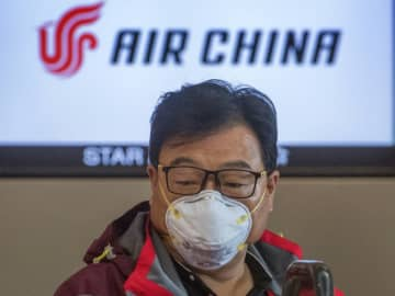 Several countries have banned flights to and from China as the coronavirus continues to spread, fanning concerns about the impact on the world economy.