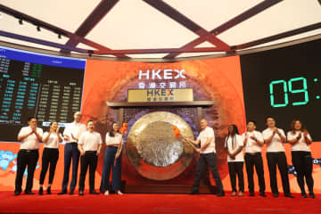 Alibaba customers and partners rang the bell at its Hong Kong listing ceremony on Nov. 26. (Image credit: Alibaba)