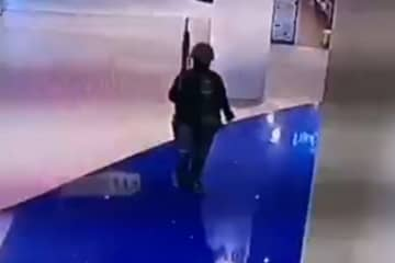 An image from security video at Terminal 21 shows the attacker entering the shopping centre around 6pm Saturday.