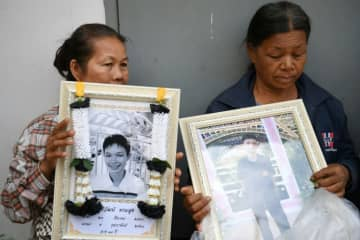 Holding portraits of their relatives and dabbing away tears, families of the victims of a mass shooting at the Terminal 21 shopping mall, arrived at a city morgue in Nakhon Ratchasima.
