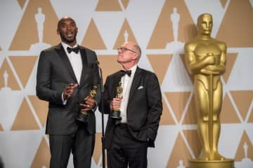 Glen Keane and Kobe Bryant pose 90th Oscars®, Academy Awards, Press Rooms credit: Michael Yada / A.M.P.A.S.
