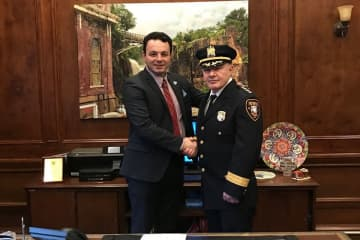 "Mayor Andre Sayegh (left) shakes hands with newly-appointed Paterson Police Chief Ibrahim ""Mike"" Baycora. Baycora is the city's first Muslim police chief. (Courtesy Photo/)"