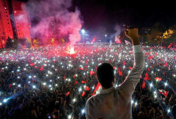 Republican People's Party candidate for mayor of Istanbul Ekrem Imamoglu celebrating in front of thousands of supporters at Beylikduzu in Istanbul. The party is boycotting CNN Turk over claims of biased coverage.