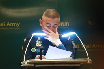 Army chief Gen Apirat Kongsompong weeps as he apologises for the mass shooting in Nakhon Ratchasima, during a media briefing at Royal Thai Army headquarters on Tuesday.Somchai Poomlard