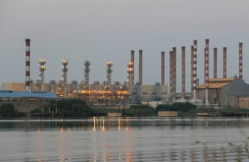 A general view of Abadan oil refinery in southwest Iran, is pictured from Iraqi side of Shatt al-Arab in Al-Faw south of Basra, Iraq September 21, 2019 (photo credit: REUTERS/ESSAM AL-SUDANI)