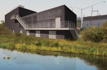 A rendering of an electric power substation NJ Transit plans to build at the North Jersey Coast Line's Bay Head terminus, overlooking a small lake and residential neighborhood. (NJ Transit/)