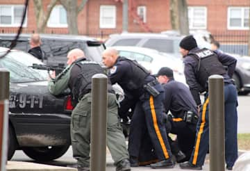 Police officers in the area of Oakland Street in Trenton's West Ward after a chase and then shooting Wed. Feb. 12, 2020. (Peterson's Breaking News/)