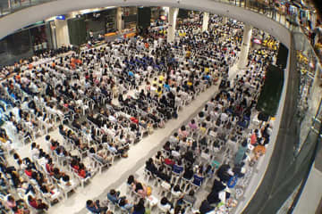 Thousands of people take part in religious ceremonies prior to the reopening of Terminal 21 in Nakhon Ratchasima on Thursday. (Photo by Prasit Tangprasert)