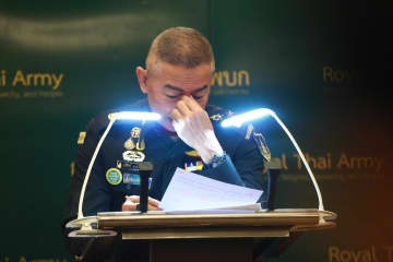 Army commander-in-chief Gen Apirat Kongsompong wipes away tears during a press conference on Tuesday while promising an overhaul of the army.Somchai Poomlard