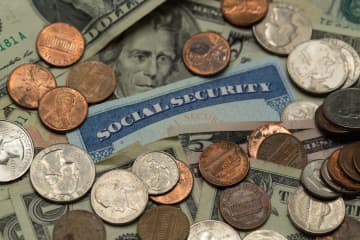 Social Security Card with amercian money surrounding it. - George Sheldon/Dreamstime