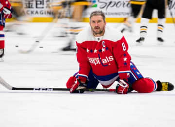 WASHINGTON, DC - FEBRUARY 02: Alex Ovechkin #8 of the Washington Capitals stretches during warm-ups before the game against the Pittsburgh Penguins at Capital One Arena on February 2, 2020 in Washington, DC.