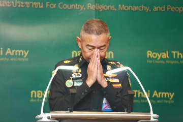 Army chief Gen Apirat Kongsompong performs a wai during a press conference following the Feb 8 massacre perpetrated by a low-ranking soldier in Korat.Bangkok Post photo