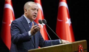 Turkey's President Recep Tayyip Erdogan speaks during a meeting in Ankara, Turkey, Tuesday, Feb. 11, 2020.