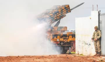 A Turkish military mobile rocket launcher fires from a position in Idlib toward Syrian regime forces' positions on Friday.