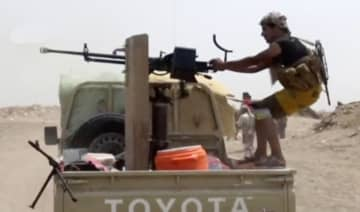Shots are fired from a vehicle during heavy fighting between the Yemeni government and Houthis in Hodeidah, Yemen, in this still image taken from video obtained on December 18, 2018. (REUTERS)